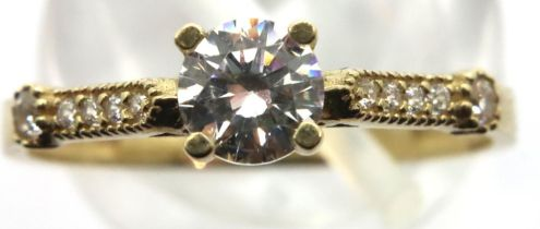 9ct gold ring with stone set shoulders, size P, 1.5g. P&P Group 1 (£14+VAT for the first lot and £