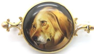 Antique gold brooch with hand painted dog panel, L: 40 mm. P&P Group 1 (£14+VAT for the first lot