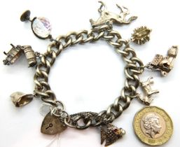 Silver charm bracelet with eight charms, combined 60g. P&P Group 1 (£14+VAT for the first lot and £