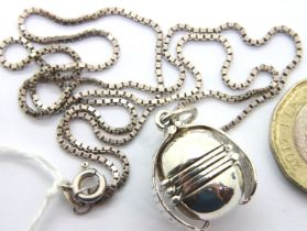 Silver ball locket on chain 13g. P&P Group 1 (£14+VAT for the first lot and £1+VAT for subsequent