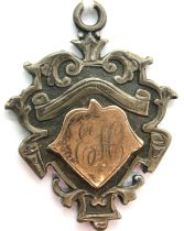 Hallmarked silver double sided fob with gold wash. P&P Group 1 (£14+VAT for the first lot and £1+VAT