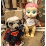 Superman Meerkat and a doll. Not available for in-house P&P, contact Paul O'Hea at Mailboxes on