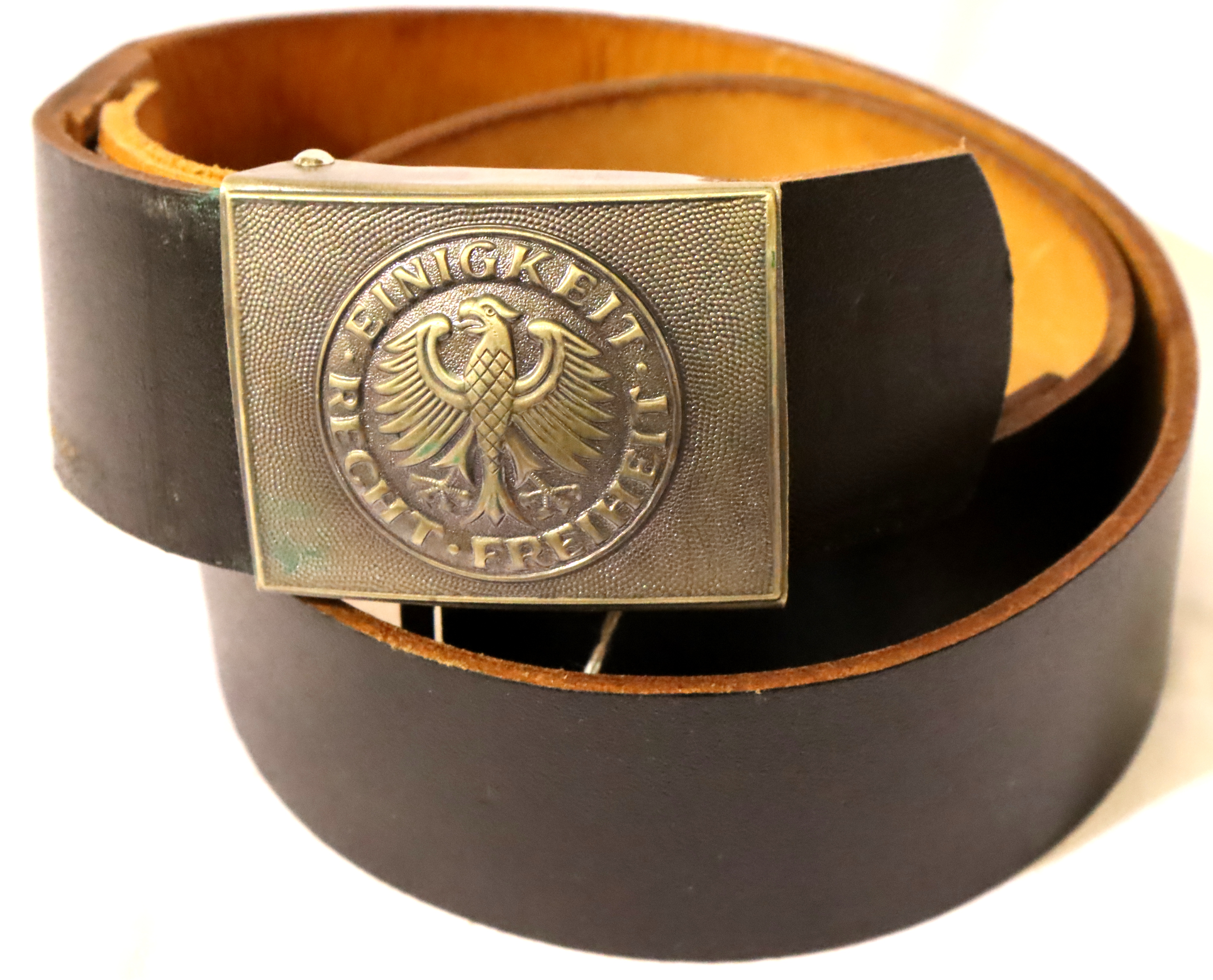 German inter-war period leather belt with pressed metal buckle. P&P Group 1 (£14+VAT for the first
