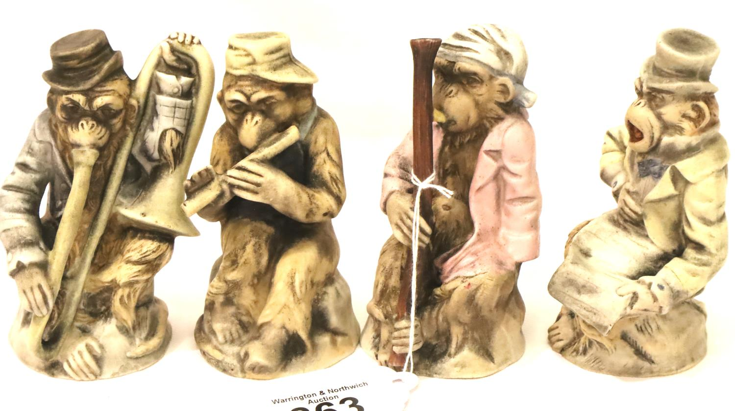 Set of four 19th/20th century Chinese monkey band figures, bisque glazed. largest H: 15 cm. P&P