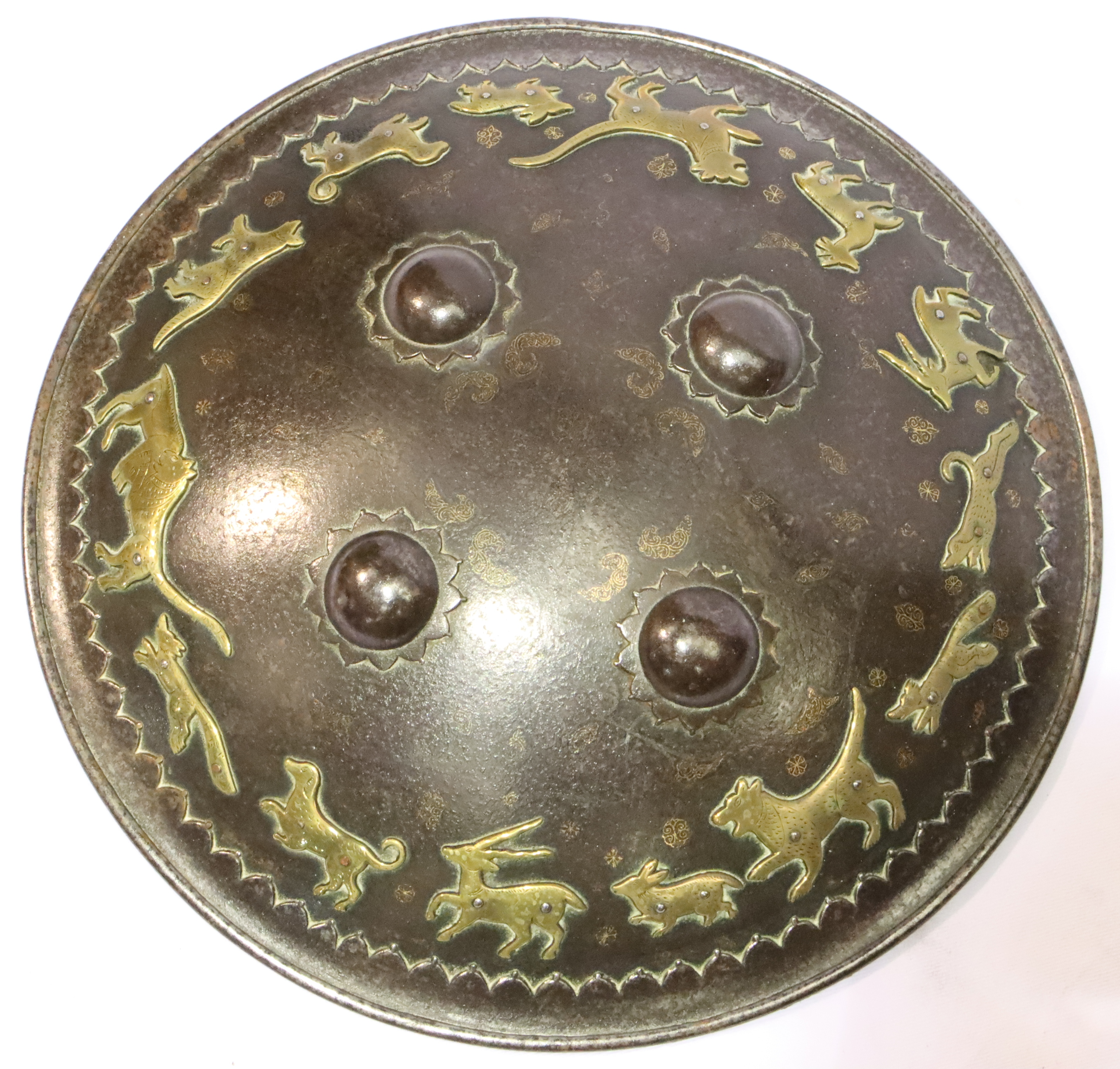 A 19th Century Indo-Persian Steel Shield, of convex circular form, with rolled rim and cut card type