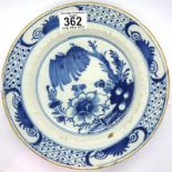 An 18th century Chinese tin glazed shallow bowl, D: 23 cm. P&P Group 2 (£18+VAT for the first lot