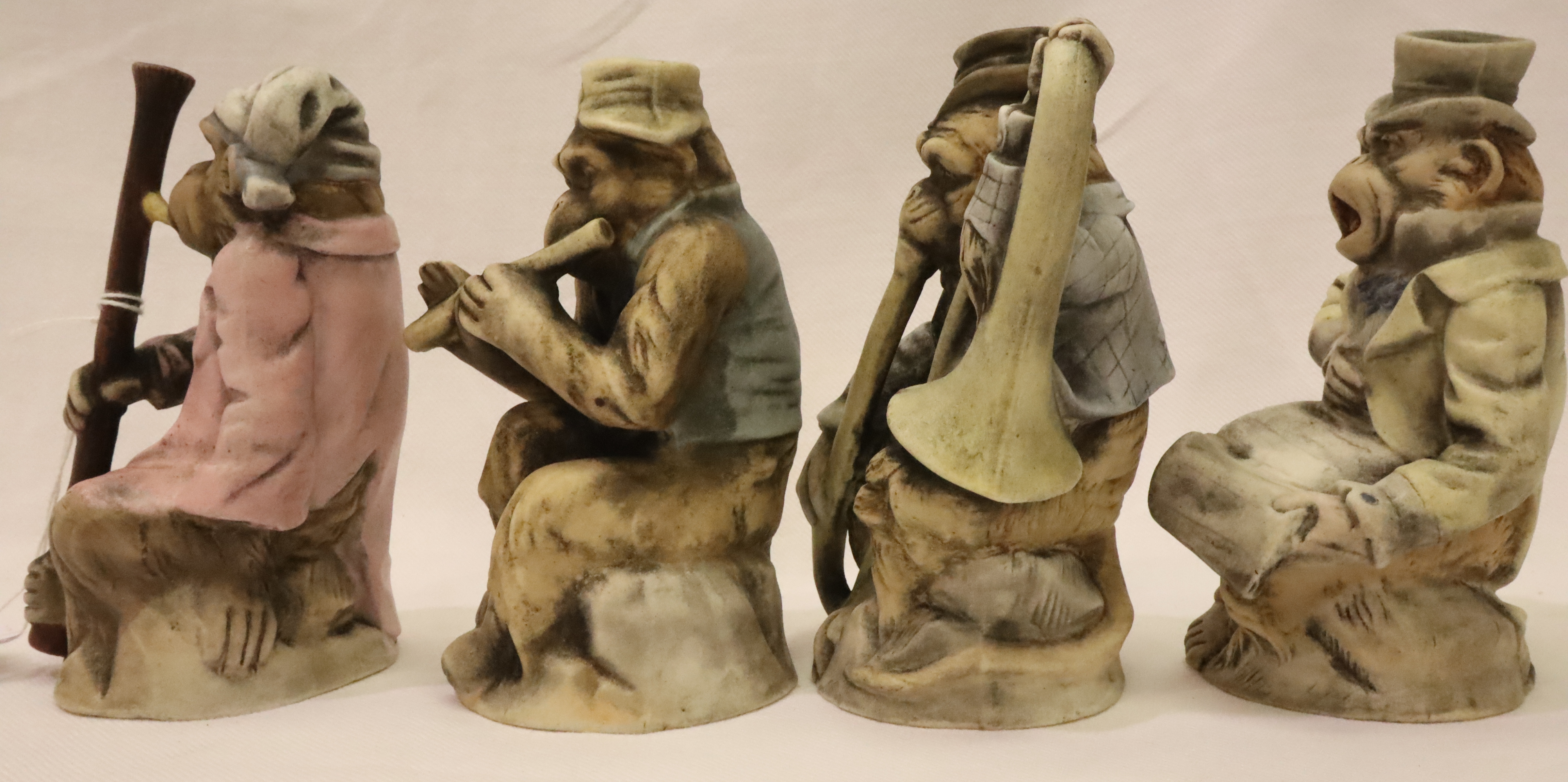 Set of four 19th/20th century Chinese monkey band figures, bisque glazed. largest H: 15 cm. P&P - Image 2 of 4