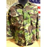 Fifty jungle camouflage DPM Grade 1 shirts. P&P Group 3 (£25+VAT for the first lot and £5+VAT for