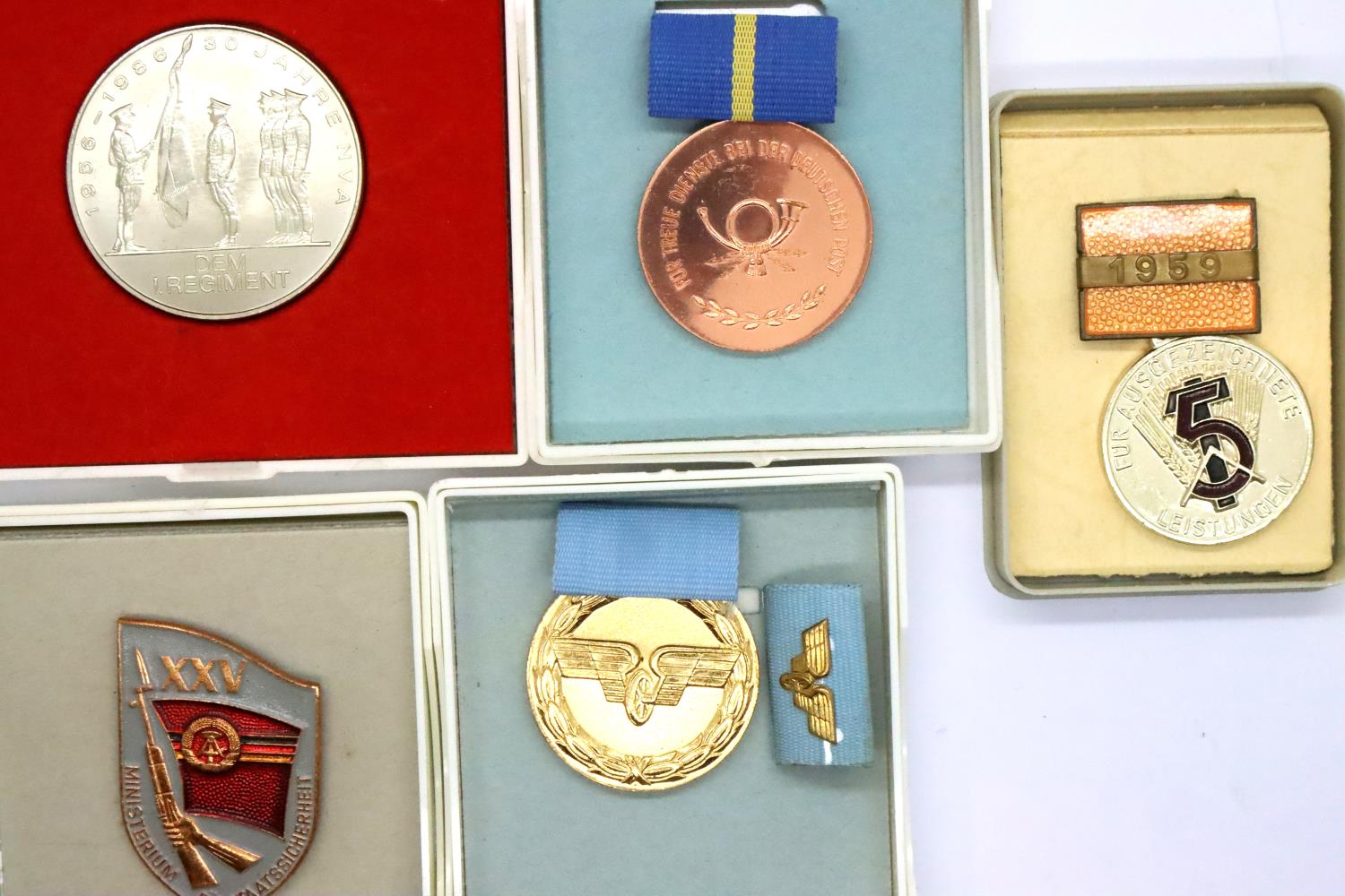 Five East German medals, boxed. P&P Group 1 (£14+VAT for the first lot and £1+VAT for subsequent