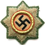 German WWII period embroidered Deutsche Cross, gold grade with green cloth back. P&P Group 2 (£18+