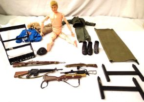 Action Man, flock hair c1964, cracks on arms and legs, also includes five rifles with rack,