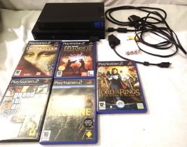 Sony Playstation 2 console with leads and five games. P&P Group 2 (£18+VAT for the first lot and £