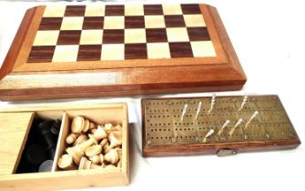 Folding wooden chess board containing a selection of non matching pieces, a boxed Staunton wooden