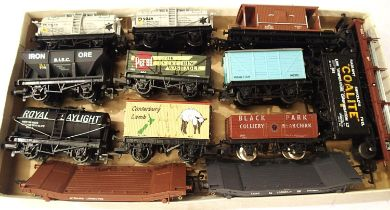 Thirteen unboxed OO scale wagons mostly Mainline, includes two Wren Lowmacs, mostly in very good