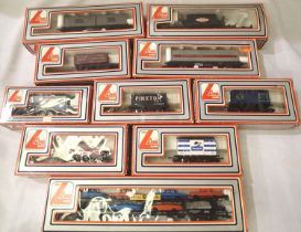 Ten boxed Lima OO scale wagons includes British Leyland car transporter with six cars, mostly in