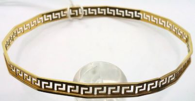 Yellow metal Greek Key design bangle. P&P Group 1 (£14+VAT for the first lot and £1+VAT for