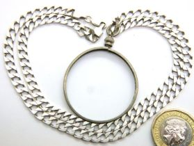 925 silver curb necklace with a coin mount pendant, 22g. P&P Group 1 (£14+VAT for the first lot