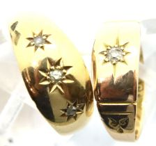 Two 15ct gold rings one set with a single stone size J, the other set with three stones size M.