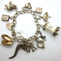 Hallmarked silver charm bracelet with twelve charms, L: 24 cm, 53g, charms not hallmarked, clasp and