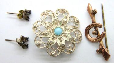 9ct gold horseshoe bar brooch, a white metal (Greek) filigree brooch and a pair of white metal and
