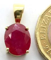 18ct gold and ruby pendant. 1.7g. P&P Group 1 (£14+VAT for the first lot and £1+VAT for subsequent