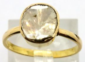 Yellow metal and 1.5ct rough cut diamond solitaire in closed back ring, size O. P&P Group 1 (£14+VAT