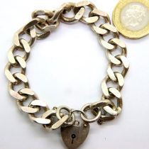 Hallmarked silver curb link bracelet with padlock clasp, 44g. P&P Group 1 (£14+VAT for the first lot