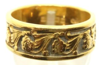22ct gold band ring, floral designed in relief, Birmingham 1963, size P, 8.4g. Some minor surface