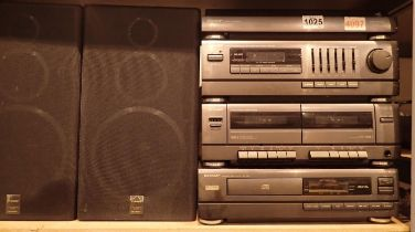 A Sharp hi-fi system to include a turntable, tape deck, CD player etc. Not available for in-house