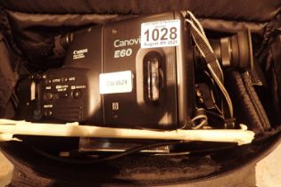 Cased Canon E60 Canovision video camera. P&P Group 2 (£18+VAT for the first lot and £3+VAT for