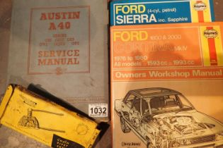 Two Haynes car repair manuals, Sierra and Cortina, a vintage Austin A40 manual and a motorcycle
