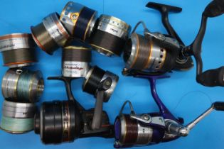 Three Daiwa fishing reels and eight spare spools. P&P Group 2 (£18+VAT for the first lot and £3+