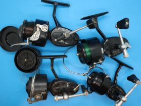 Four Mitchell fishing reels models 300, 308,330 and a 440A and spare reel. P&P Group 2 (£18+VAT