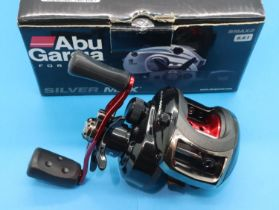 ABU Garcia Black Max Baitcaster fishing reel. P&P Group 2 (£18+VAT for the first lot and £3+VAT