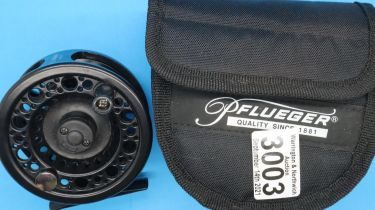 Cased Omni fly reel. P&P Group 2 (£18+VAT for the first lot and £3+VAT for subsequent lots)