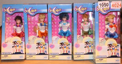 Five boxed collectable Irwin toys Japanese Sailor Moon adventure dolls. Not available for in-house