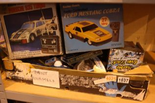 Box of mixed toys and games including remote control cars. Not available for in-house P&P, contact