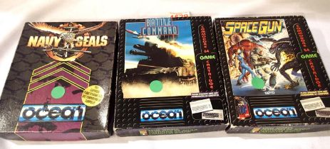 Three commodore boxed games cartridges to include Navy Seals Battle Command and spare gun. P&P Group