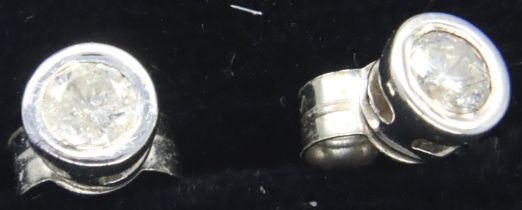 Pair of 9ct white gold diamond set earrings, 0.9g. P&P Group 1 (£14+VAT for the first lot and £1+VAT