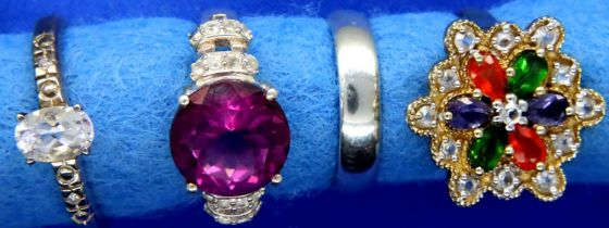 Four sterling silver rings including three stone set. P&P Group 1 (£14+VAT for the first lot and £