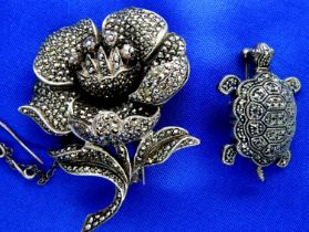 Two 925 silver and marcasite set brooches, combined 36g. P&P Group 1 (£14+VAT for the first lot