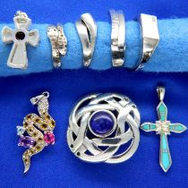 Four 925 silver rings, three pendants and a pin brooch, combined 38g. P&P Group 1 (£14+VAT for the