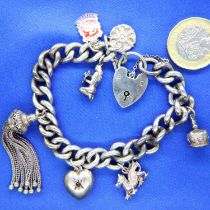 Silver charm bracelet with seven charms. P&P Group 1 (£14+VAT for the first lot and £1+VAT for