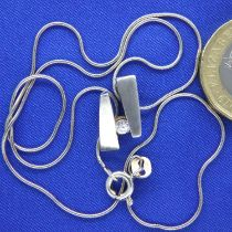 Sterling silver neck chain with a diamond set pendant, chain L: 38 cm, pendant D: 14 mm. P&P Group 1