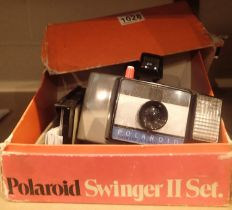 Boxed Polaroid Swinger 2 camera. Not available for in-house P&P, contact Paul O'Hea at Mailboxes
