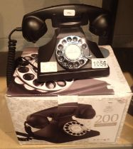 The GPO 200 rotary telephone has a metal base and handset; traditional cloth handset curly cord & is
