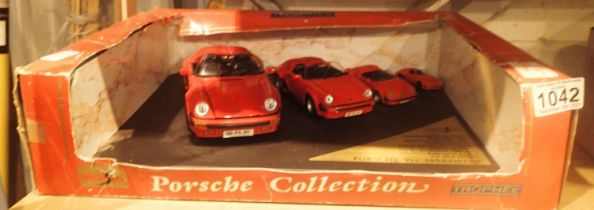 Boxed set of four model Porsche cars. P&P Group 2 (£18+VAT for the first lot and £3+VAT for