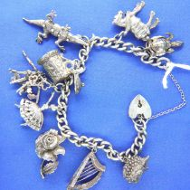 Sterling silver charm bracelet, nine charms, L: 18 cm, 55g. P&P Group 2 (£18+VAT for the first lot