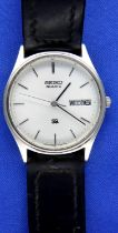 Seiko; gents vintage day date wristwatch, working at lotting. P&P Group 1 (£14+VAT for the first lot