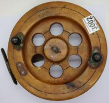 A 9 inch Shakespeare wood and brass fishing reel. Not available for in-house P&P, contact Paul O'Hea